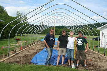 Students in front of greenhouse
