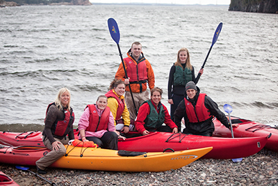 Group of students with kayaks