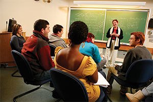 Students listening to teacher in classroom