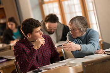 Student listening to teacher