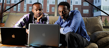Two students looking at laptop