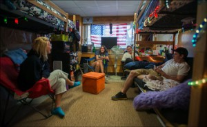 Students hanging out in a UMaine dorm room