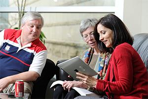 Teachers lookint at iPad